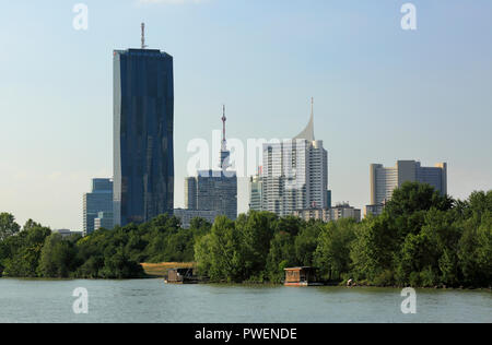 Austria, A-Vienna, Danube, Federal Capital, skyline of the Donau City, f.l.t.r. Ares Tower, Commercial Tower, DC Tower 1, Commercial Tower, skyscraper, Mischek Tower, apartment tower, Donau Tower, highrise Neue Donau, apartment tower, UNO City with VIC Vienna International Centre and Austria Center Vienna, river landscape, Danube landscape, Danube promenade, Danube bank - Stock Photo