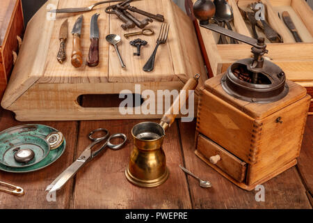 A photo of many vintage objects, flea market stuff on a wooden table - Stock Photo