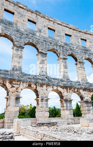 Pula, Croatia - June 18, 2014: Facade wall arc columns rows in Pula Arena. The most famous and important monument in Pula popularly called the Arena o - Stock Photo