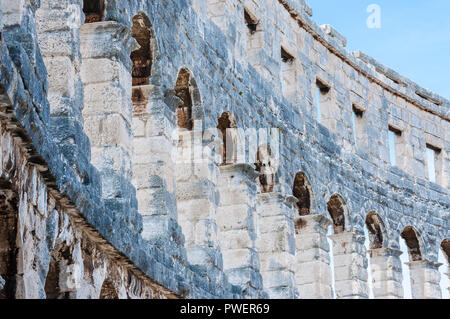 Pula, Croatia - June 18, 2014: Stone arc columns rows in Pula Arena. The most famous and important monument in Pula, popularly called the Arena of Pul - Stock Photo