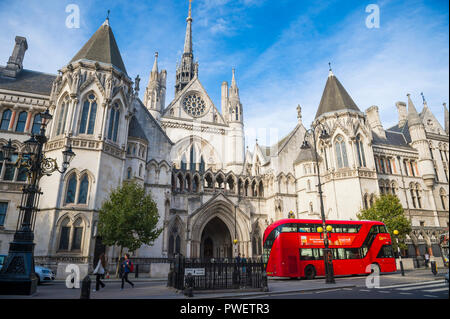 LONDON - OCTOBER 13, 2018: A modern Routemaster double-decker bus passes in front of the landmark Royal Courts of Justice on Fleet Street. - Stock Photo