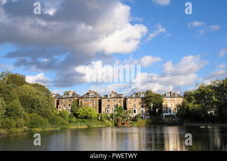 Houses of South Hill Park overlooking Hampstead No 2 Pond on Hampstead Heath, London NW3, England, UK - Stock Photo