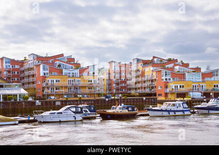 Boats and riverside apartments at Teddington Lock on the River Thames - Stock Photo