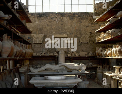 Antiquarium. Small museum with remains of city of Pompeii after the Vesuvius eruption. Inside view. Pottery and plaster casts of human body. Pompeii. Italy. - Stock Photo