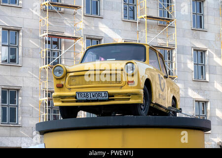 A Trabant car at the Berlin Wall which separated East and West Germany in Berlin between 1961-1989. The car was produced between 1957 to 1990. - Stock Photo