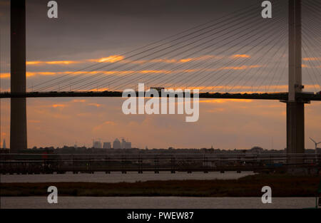 A London bus crosses the River Thames over the Dartford Crossing or Queen Elizabeth Bridge between Essex and Kent, England. - Stock Photo