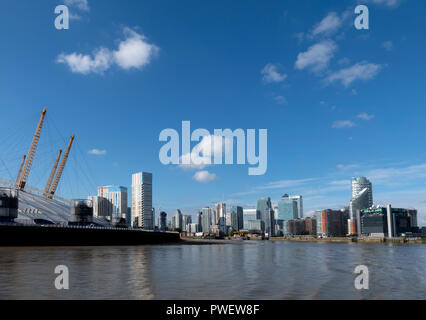 London O2 Arena / Millennium Dome at Greenwich Docklands and the skyline of Canary Wharf. - Stock Photo