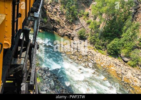 Traintracks along the Narrow Gauge Railroad from Durango to Silverton through Cascade canyon alongside the River animas, Colorado, USA - Stock Photo
