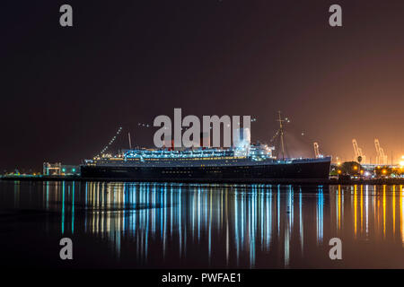 Night view of the RMS Queen Mary in Long Beach, California - Stock Photo