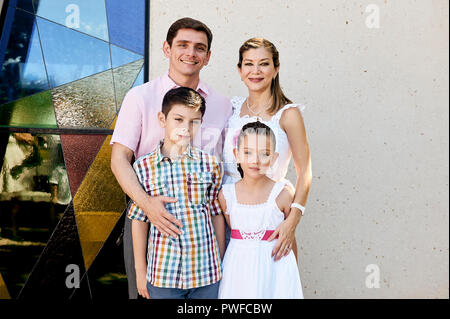 MERIDA, YUC/MEXICO - NOV 18, 2017: Portrait of mexican family outside church, after attending the baptism of twin nephews. - Stock Photo