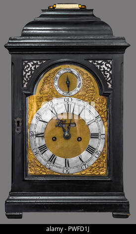 Antique table clock housed in carved wooden box on isolated gray background with clipping path. - Stock Photo