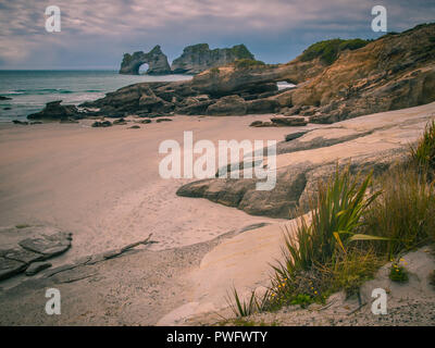 Coastal Rock formations on Wharariki Beach, North Island, New Zealand - Stock Photo