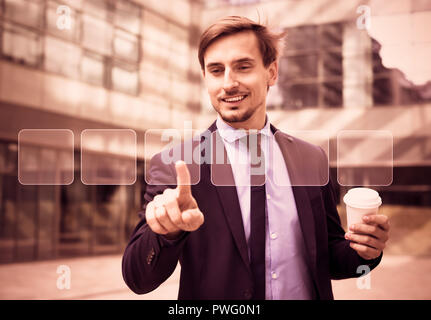 Business man pressing high tech type of modern buttons on virtual background - Stock Photo