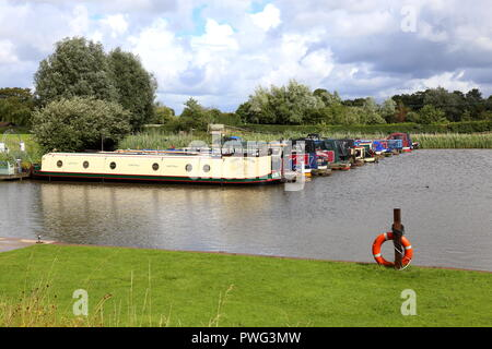 Rufford Marina, Lancashire. Canal Narrowboats are tied up at their moorings. - Stock Photo