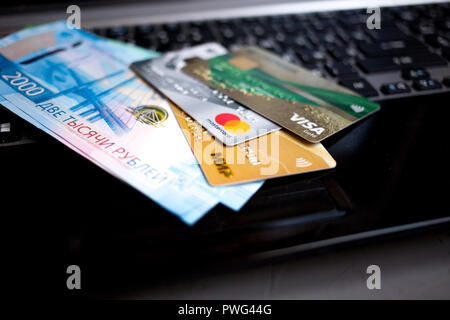 MOSCOW, RUSSIA - 08 28 2018: banknotes Russian rubles and credit cards are on the laptop keyboard - Stock Photo