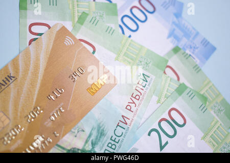 MOSCOW, RUSSIA - 08 28 2018: banknotes Russian rubles and credit cards on the blue background - Stock Photo