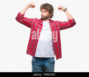 Handsome hispanic model man over isolated background showing arms muscles smiling proud. Fitness concept. - Stock Photo