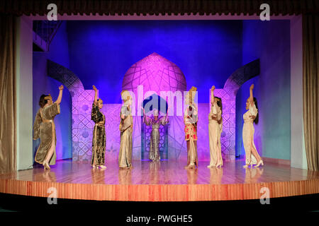 """Actors wearing costumes of Sogdian period of Persian Empire, IV-VII AD during an ethno-cultural performance staged by """"El Merosi"""" ('The People's Heritage') the theater of historical costumes working since 2005 in the city of Samarkand alternatively Samarqand of the Timurid dynasty in Uzbekistan - Stock Photo"""