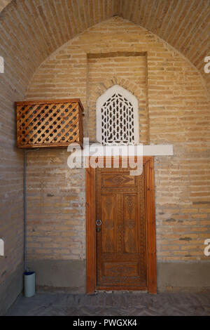 Entrance top a typical room at the Orient Star Khiva hotel located in the Ichan-Kala historic city of Khiva the former capital of Khwarezmia and the Khanate of Khiva listed as Unesco world heritage site located in Xorazm Region, Uzbekistan - Stock Photo