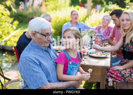 Family picnic closeup on a grandfather and his granddaughter - Stock Photo