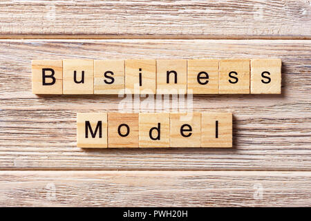 Business model word written on wood block. Business model text on table, concept. - Stock Photo
