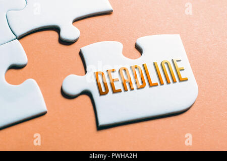 The Word Deadline In Missing Piece Jigsaw Puzzle - Stock Photo