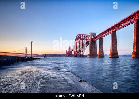 Forth Rail bridge, Queensferry, Edinburgh, East Lothian, Scotland, UK, one of the most famous bridges in the world and an icon of Scotland, at sunset. - Stock Photo