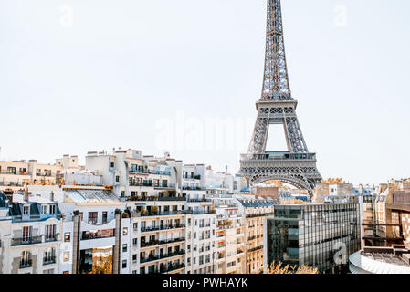 Beautiful cityscape view with residential buildings and Eiffel tower during the daylight in Paris - Stock Photo
