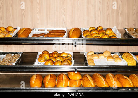 assortment of different kind of cereal bakery, Freshly baked bread and buns - Stock Photo
