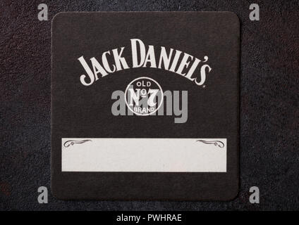 LONDON, UK - AUGUST 22, 2018:Jack Daniel's paper mat coaster on black background. - Stock Photo