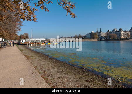 The Pavillon Bar and the Coffee Saloon and Boat Rental at the Peblinge Dossering and Peblinge Lake in Copenhagen on a sunny and warm indian summer day - Stock Photo
