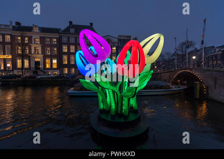 Amsterdam,canal Herengracht with lights and artwork Bunch of Tulips by Peter Koros during Amsterdam Light Festival in winter. - Stock Photo