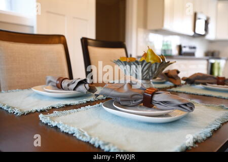 Light interior of kitchen and dining room in American house - Stock Photo