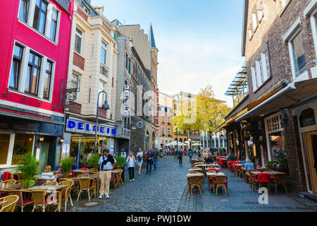 Aachen, Germany - October 12, 2018: road in the old town with unidentified people. Aachen is a spa town in North Rhine-Westphalia and was residence of - Stock Photo