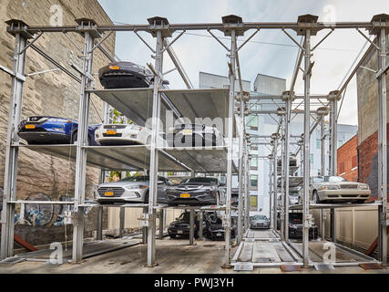 New York City, USA - July 06, 2018: Elevated parking system in Williamsburg neighborhood, designed to minimize the area required for parking cars. - Stock Photo