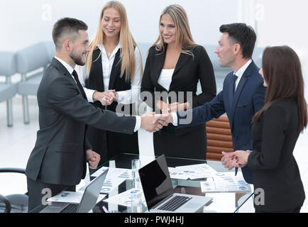 handshake business partners after discussion of the contract - Stock Photo