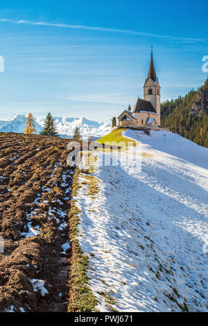 The church of the little village of Schmitten surrounded by snow Albula District Canton of Graubünden Switzerland Europe - Stock Photo