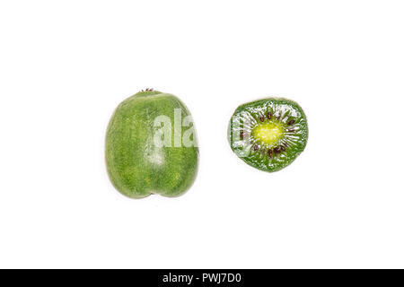 Group of one whole one half of fresh green mini baby kiwi fruit flatlay isolated on white background - Stock Photo