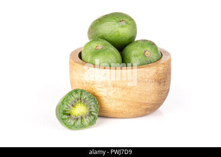 Lot of whole one half of fresh green mini baby kiwi fruit with wooden bowl isolated on white background - Stock Photo