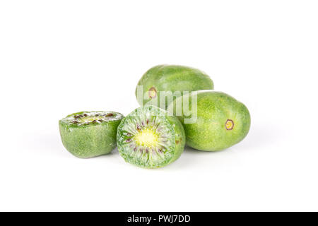 Group of two whole two halves of fresh green mini baby kiwi fruit isolated on white background - Stock Photo