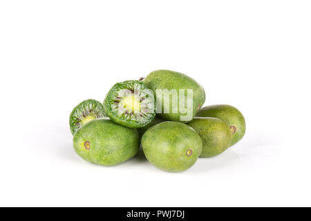 Stack of lot of whole two halves of fresh green mini baby kiwi fruit isolated on white background - Stock Photo