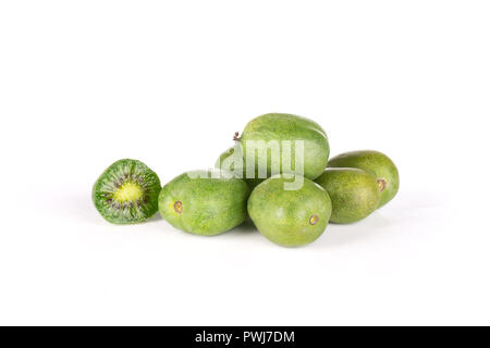 Lot of whole one half of fresh green mini baby kiwi fruit isolated on white background - Stock Photo