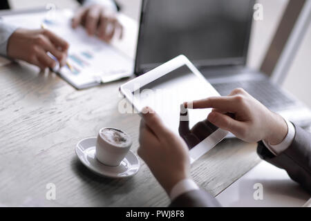close up.the businessman uses a tablet to work with financial da - Stock Photo