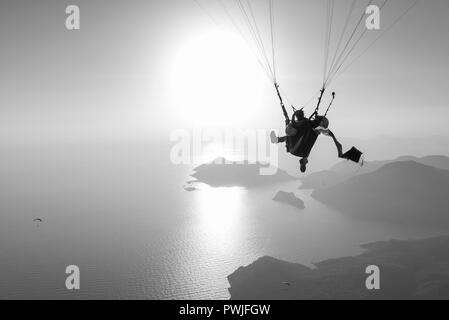Paragliding during sunset - Stock Photo