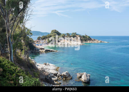Small beach by the pretty coastal village of Kassiopi in north east Corfu - Stock Photo