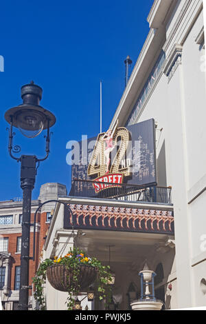 London, Covent Garden.   The Theatre Royal, Drury Lane, advertising the latest in a succession of long-running musicals. - Stock Photo