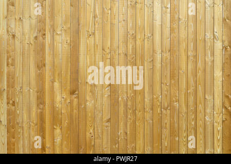 Wooden wall made of vertical boards - Stock Photo