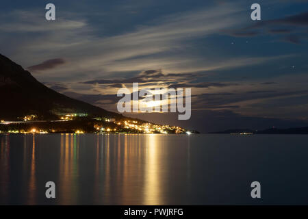 Omis city view near the mountain in Croatia at evening. - Stock Photo