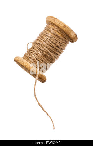 Coil with threads from linen fiber isolated on white background - Stock Photo