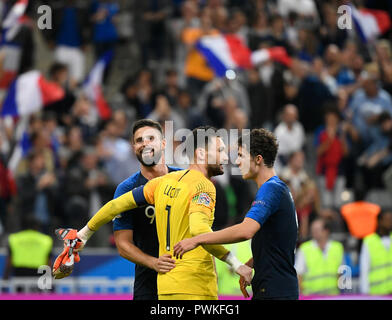 16 October 2018, France, Paris: Soccer: Nations League A, France - Germany, Group stage, Group 1, 4th matchday at the Stade de France. Olivier Giroud (l-r), goalkeeper Hugo Lloris and Benjamin Pavard cheer for a 2-1 victory after the match. Photo: Ina Fassbender/dpa - Stock Photo